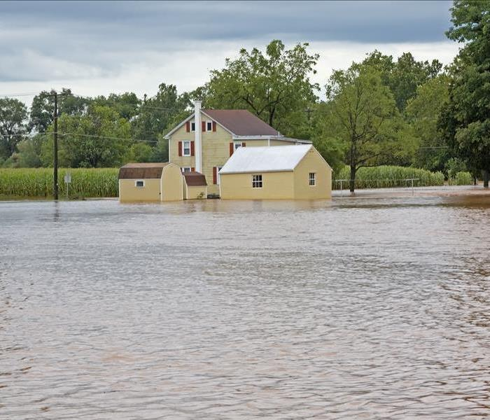 A home with standing water all around the property.