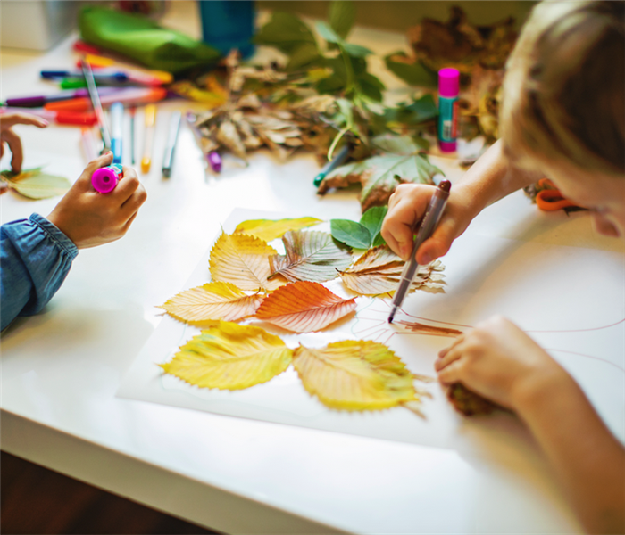 children drawing and making art from leaves