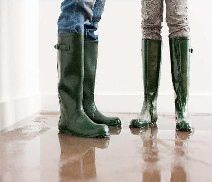 flooding in property - image of boots on wet floor